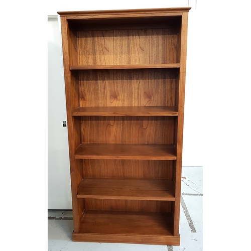 484 - LARGE TEAK BOOKCASE with a moulded top above five shelves, standing on a plinth base, 197.5cm x 99cm...