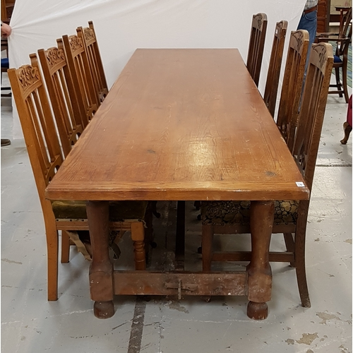 487 - PINE PLANK TOP REFECTORY TABLE standing on turned supports united by a stretcher, 318cm long...