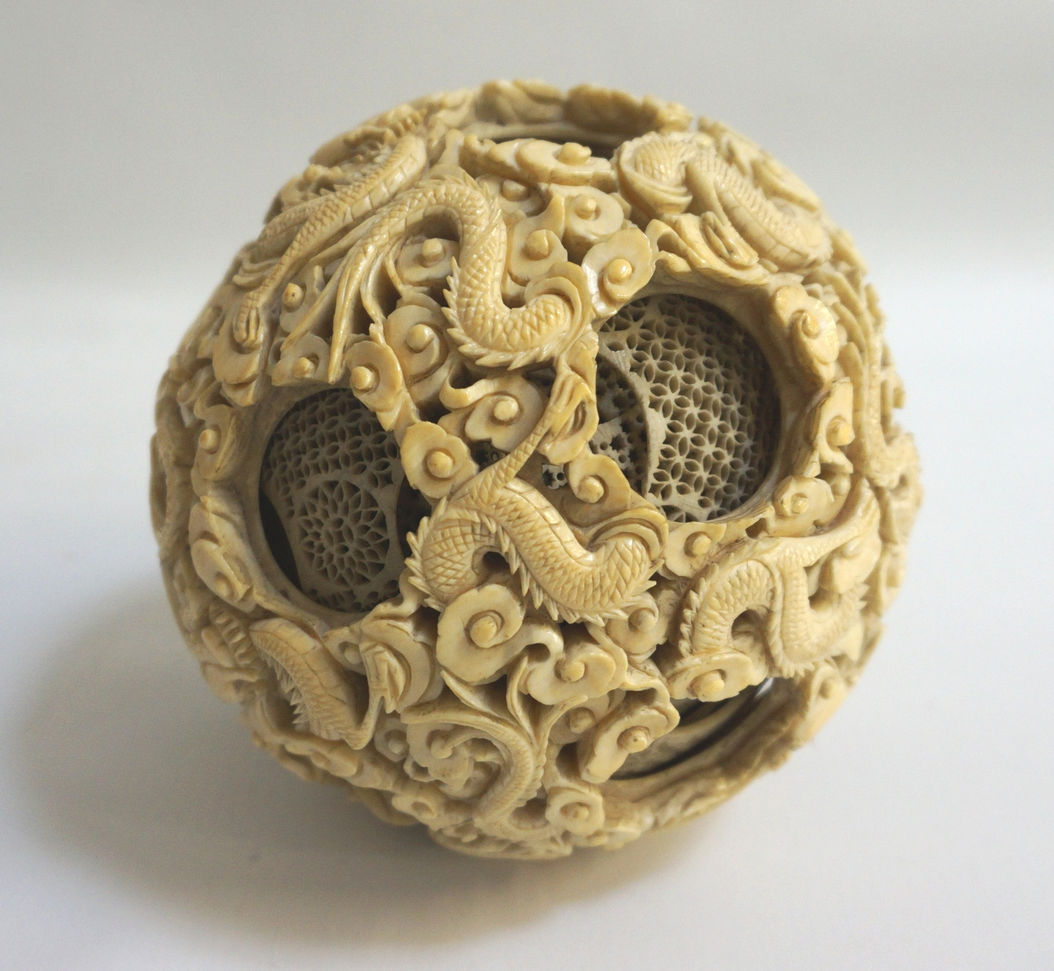 Very Large Chinese Ivory Puzzle Ball With Profuse Carved Dragon Decoration The Interior Spheres Wit