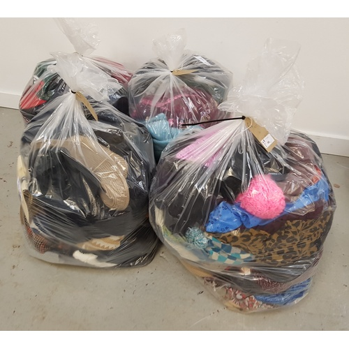 48 - FOUR BAGS OF HATS AND SCARVES...