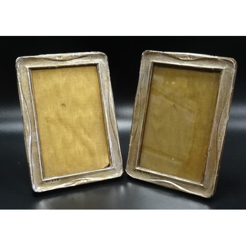 114 - PAIR OF GEORGE V SILVER PHOTOGRAPH FRAMES of rectangular form with raised detail, Birmingham 1918, o...