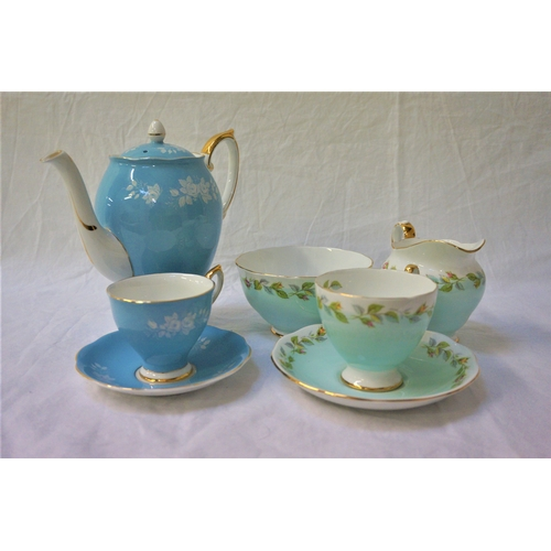 133 - ROYAL STANDARD COFFEE SERVICE decorated with a light blue ground with white flower heads and gilt hi...