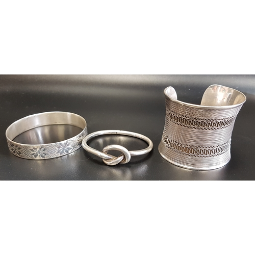4 - LARGE SILVER CUFF BANGLE with rope twist detail; together with two further silver bangles, one with ...