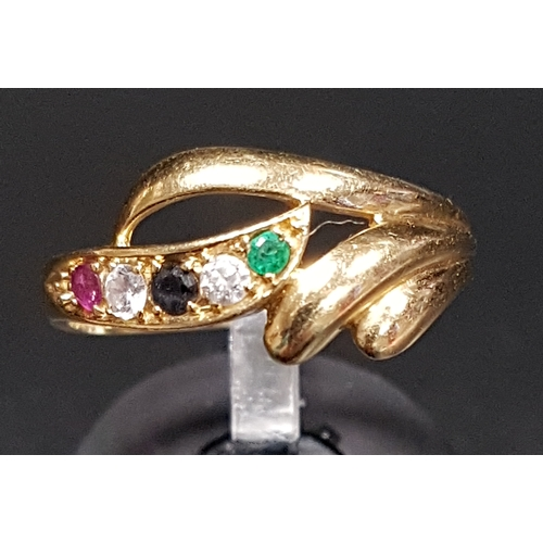 12 - ATTRACTIVE SAPPHIRE, EMERALD, RUBY AND CZ DRESS RING the multi gemstones in decorative scroll settin...