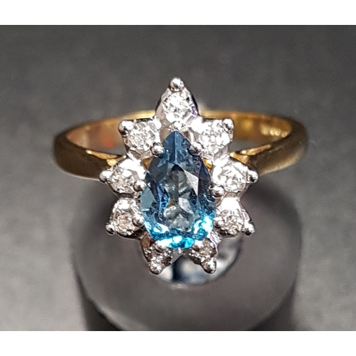 32 - BLUE TOPAZ AND DIAMOND CLUSTER RING the pear cut blue topaz approximately 0.75cts in nine diamond su...