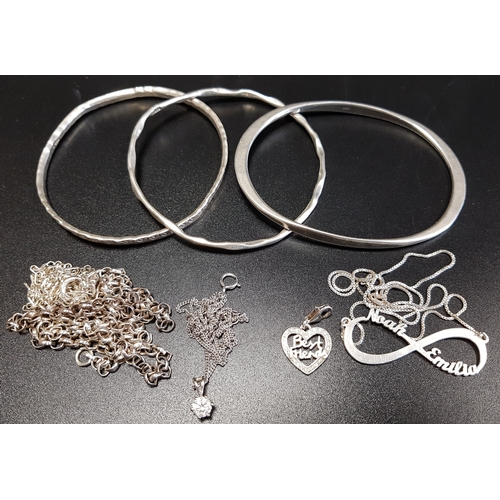 41 - SELECTION OF SILVER JEWELLERY including three bangles, silver pendants and chains, and a Thomas Sabo...