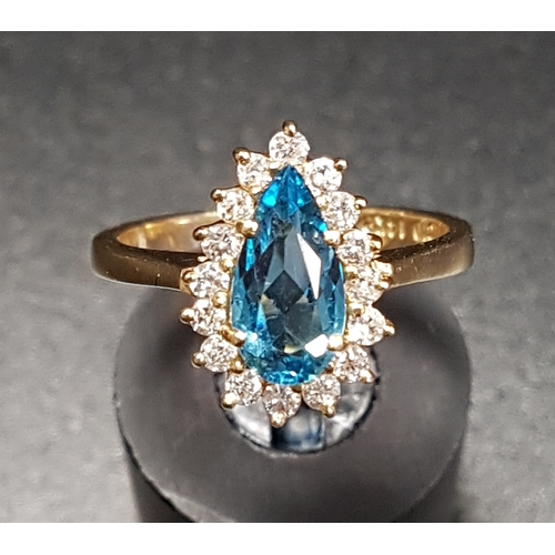 48 - BLUE TOPAZ AND DIAMOND DRESS RING the central blue topaz approximately 1ct in sixteen diamond surrou...