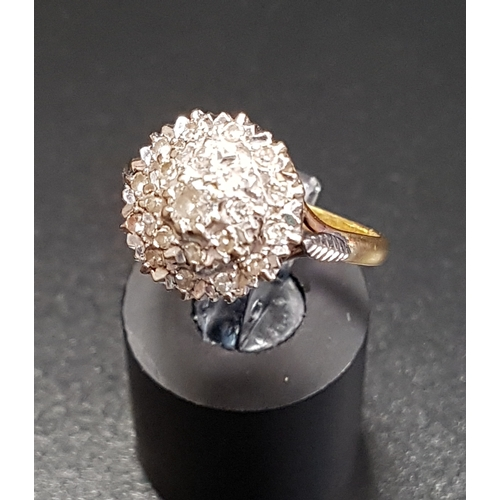 101 - DIAMOND CLUSTER DRESS RING on eighteen carat gold shank with stepped setting, ring size M...