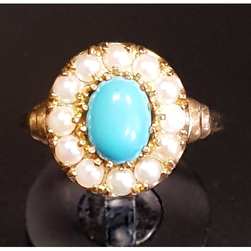 16 - TURQUOISE AND SEED PEARL CLUSTER RING the central oval cabochon turquoise stone in twelve pearl surr...