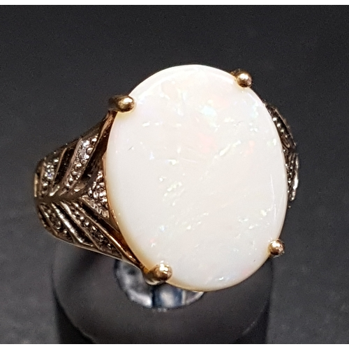 45 - OPAL AND DIAMOND DRESS RING the central oval opal flanked by diamond set split shoulders, on nine ca...