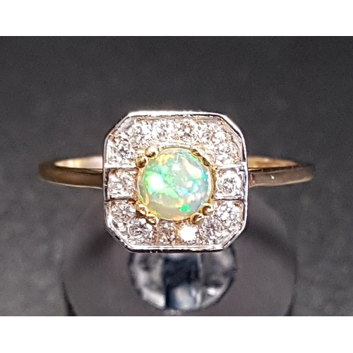 46 - OPAL AND DIAMOND CLUSTER RING the central round cabochon opal in fourteen diamond surround, on eight...