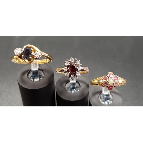 77 - THREE DIAMOND AND GEM SET SILVER GILT RINGS comprising a sapphire and diamond three stone ring of tw...