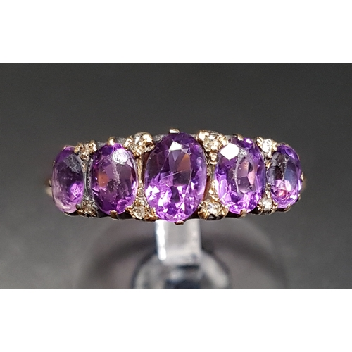 79 - GRADUATED OVAL CUT AMETHYST FIVE STONE RING with small diamond accents, on eighteen carat gold shank...