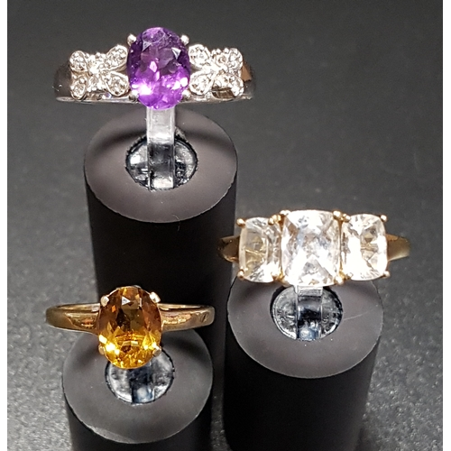 86 - THREE DIAMOND AND GEM SET RINGS comprising an amethyst and diamond cluster ring on silver shank, rin...