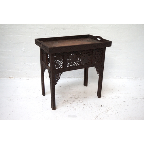 392 - INDONESIAN CARVED TEAK OCCASIONAL TABLE the removable tray top with handles and carved floral decora...