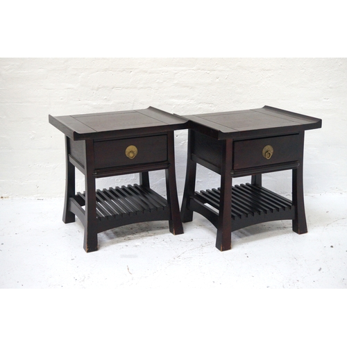 394 - PAIR OF CHINESE HARDWOOD OCCASIONAL TABLES with shaped turn up tops above a single drawer, standing ...
