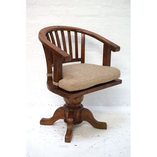 479 - TEAK CAPTAIN'S STYLE SWIVEL CHAIR with a hoop back above a solid seat with a shaped cushion, raised ...