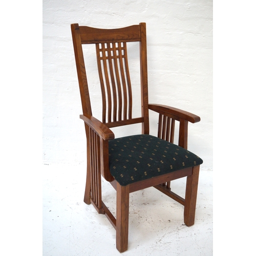 491 - ART NOUVEAU STYLE ELM ARMCHAIR with a shaped top rail above six shaped narrow splats with shaped arm...