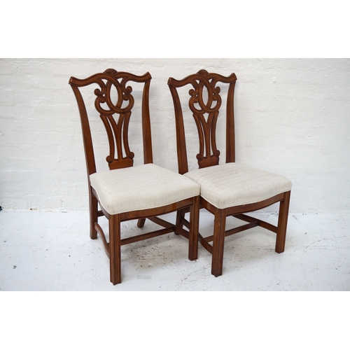 493 - PAIR OF CHIPPENDALE STYLE MAHOGANY DINING CHAIRS with shaped top rails above a carved and pierced sp...