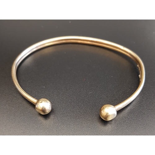 1 - NINE CARAT GOLD BANGLE with ball finials, approximately 5.7 grams...