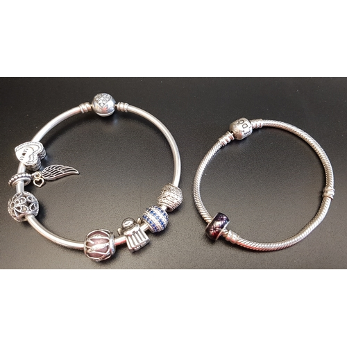3 - PANDORA MOMENTS SILVER BANGLE with heart clasp and seven charms including an angel, a Mum heart and ...