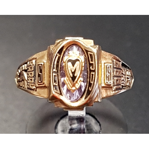 15 - TEN CARAT GOLD COLLEGE RING BY JOSTENS the central M in heart shaped cartouche, flanked by relief de...