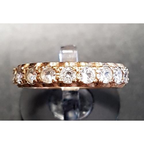 25 - CLEAR GEM SET ETERNITY RING in nine carat gold, ring size L...