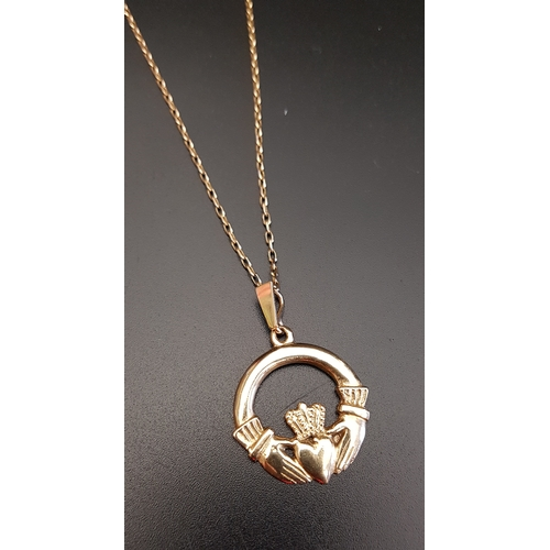31 - NINE CARAT GOLD CLADDAGH PENDANT on nine carat gold chain, total weight approximately 7.3 grams...