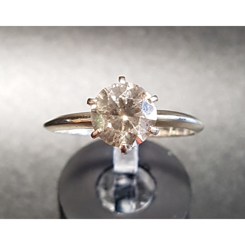 37 - DIAMOND SOLITAIRE RING the round brilliant cut diamond approximately 1.5cts, on fourteen carat gold ...