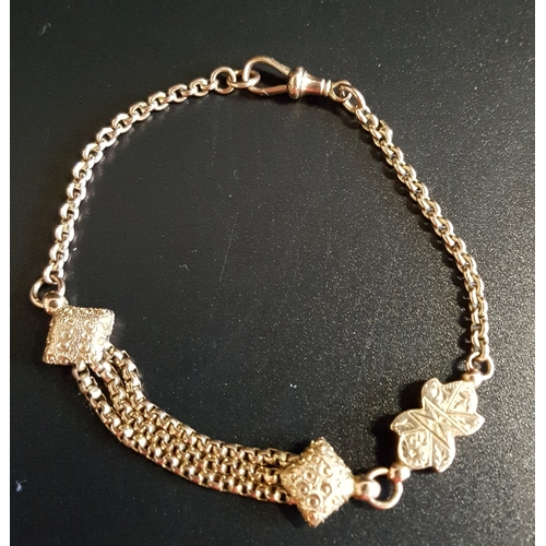 40 - UNUSUAL NINE CARAT GOLD ALBERTINA BRACELET with central shaped links and triple chain section, 20cm ...