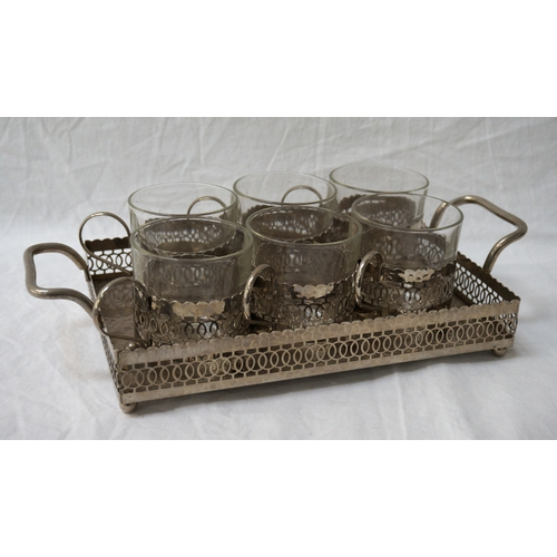 123 - SET OF SIX SILVER PLATED GLASS HOLDERS AND TRAY each of the glass holders with pierced decoration an...