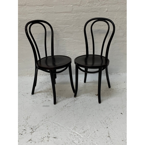 372 - SET OF SIX BENTWOOD BISTRO STYLE CHAIRS the stained shaped backs above circular seats, standing on t...