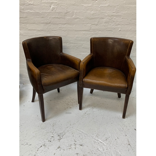 373 - SET OF SIX UHS CHADWICK TUB CHAIRS with shaped backs and arms covered in brown faux leather, standin...