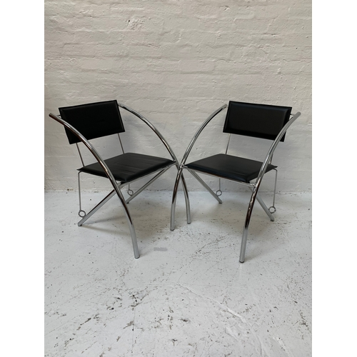 405 - SET OF FOUR CHROME FRAME DINING CHAIRS with rectangular padded backs above square padded seats, on s...