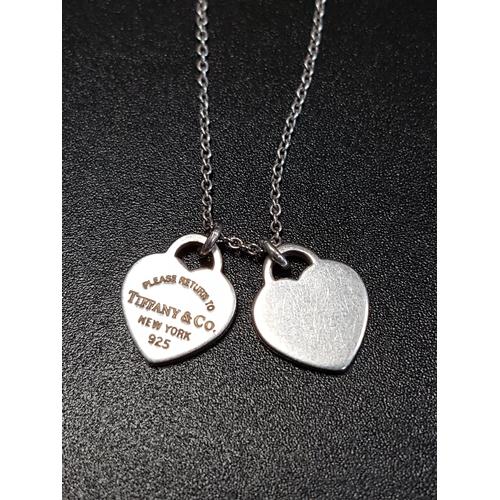 51 - TIFFANY & CO. 'RETURN TO TIFFANY' MINI DOUBLE HEART TAG SILVER PENDANT  on silver Tiffany chain, one...