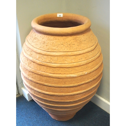 380 - LARGE TERRACOTTA POT of bulbous form with ribbed decoration, 81cm high...
