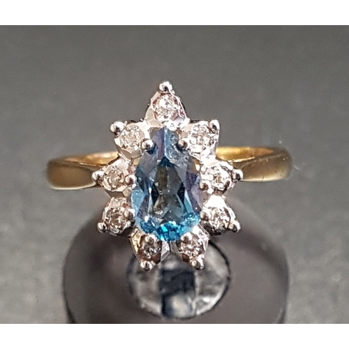 10 - BLUE TOPAZ AND DIAMOND CLUSTER RING the pear cut blue topaz approximately 0.75cts in nine diamond su...