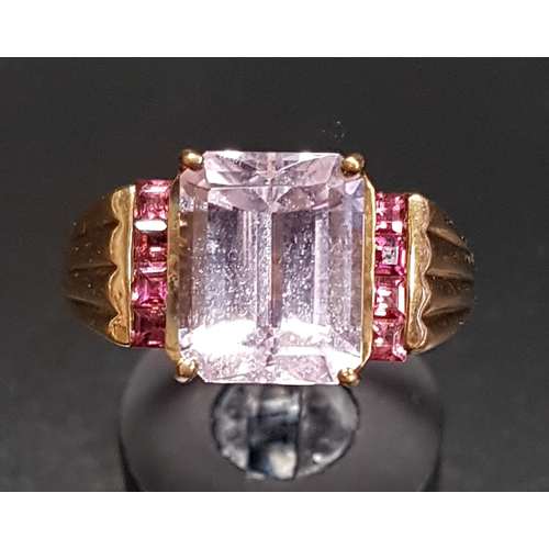 20 - KUNZITE AND PINK GEM SET DRESS RING the central emerald cut kunzite with a vertical row of pink gems...