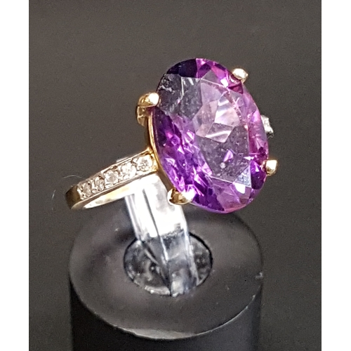 21 - AMETHYST AND DIAMOND DRESS RING the large central oval cut amethyst approximately 5cts, flanked by d...