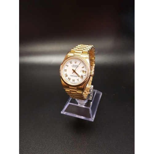 28 - MID SIZE 18CT GOLD ROLEX OYSTER PERPETUAL DATEJUST WRIST WATCH on a gold president bracelet, the flu...