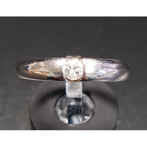 32 - TENSION SET DIAMOND SOLITAIRE RING the round brilliant cut diamond approximately 0.2cts, on nine whi...
