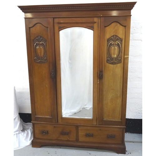 353 - ART NOUVEAU MAHOGANY WARDROBE with a moulded dentil cornice above a shaped central bevelled mirror d...