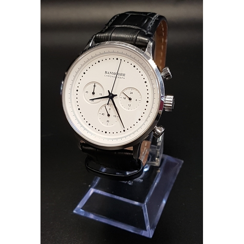 6 - GENTLEMEN'S BANMOORE CHRONOGRAPH WRISTWATCH the white dial with three subsidiary dials, the backplat...