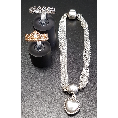 9 - SMALL SELECTION OF PANDORA JEWELLERY comprising a multi strand clip station bracelet with heart char...