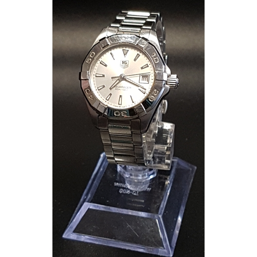 13 - LADIES TAG HEUER AQUARACER WRISTWATCH the silvered dial with luminous five minute markers and date a...