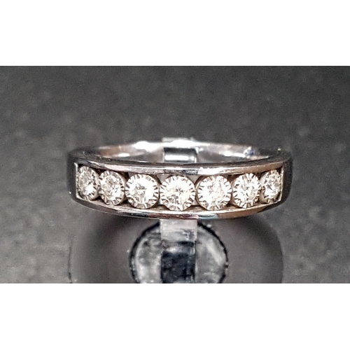 17 - DIAMOND HALF ETERNITY RING  the channel illusion set diamonds totalling approximately 0.25cts, in ni...