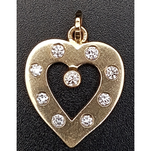 24 - DIAMOND SET HEART SHAPED PENDANT the diamonds totalling approximately 0.35cts, in unmarked gold...