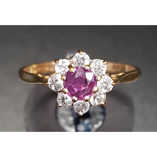 27 - RUBY AND CZ CLUSTER RING on nine carat gold shank, ring size M-N...