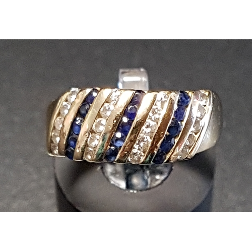31 - DIAMOND AND SAPPHIRE DRESS RING with alternating diagonal rows of diamonds and sapphires, in fourtee...