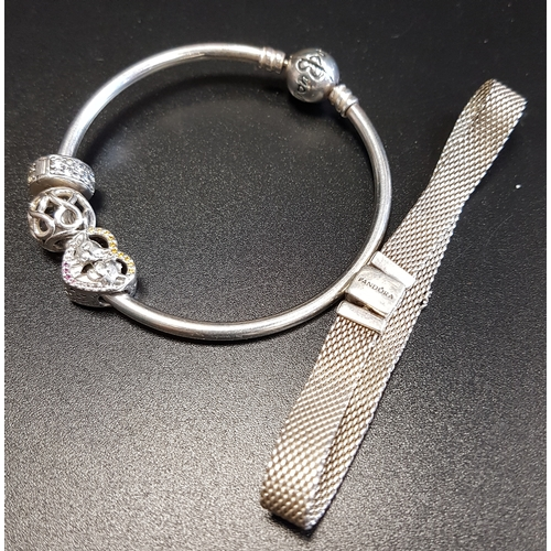 38 - PANDORA MOMENTS SILVER BANGLE with two charms and a clip; together with a Pandora silver Reflexions ...